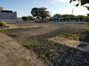 View of parking lot gravel surface
